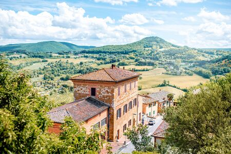 Beautiful landscape view on the meadow with old buildings in Montepulciano town in Italy