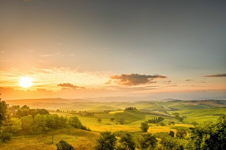 val dorcia: Beautiful tuscan landscape view in Val dOrcia region near Pienza town on the morning in Italy. Wide angle photo with copy space Stock Photo
