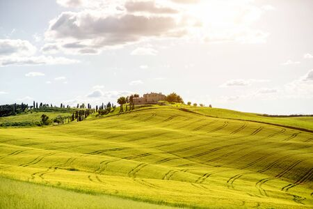 pienza: Beautiful tuscan landscape view on the green field with farmhouse near Pienza town in Italy Stock Photo