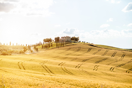 orcia: Beautiful tuscan landscape view on the green field with farmhouse near Pienza town in Italy Stock Photo