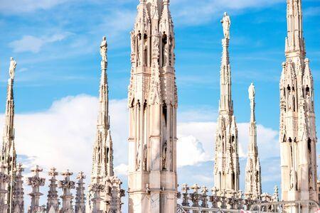 spires: Gothic spires on Duomo rooftops spires in Milan