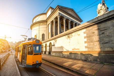 Turin cityscape view on Gran Madre square with church and old yellow tram in the morning Stock Photo