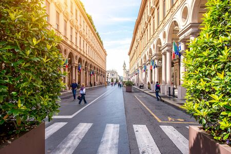 Turin, Italy - June 12, 2016: Rome central pedestrian street with shops and people walk in Turin city in the morning in Italy