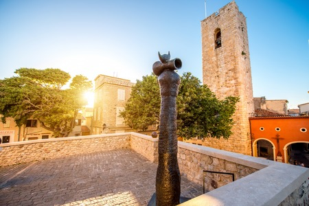 Antibes, France - June 14, 2016: Central square near art museum of Picasso with modern sculpture by Joan Miro sculptor in Antibes village in France