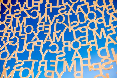 Antibes, France - June 14, 2016: Letters on the sky background. Fragment of the sculpture called Nomade in Antibes village. This sculpture is a creation by contemporary Catalan artist Jaume Plensa