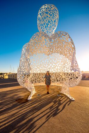 Antibes, France - June 14, 2016: Nomade, A Man of Letters Looking Out Over The Mediterranean in Antibes village. This sculpture is a creation by contemporary Catalan artist Jaume Plensa