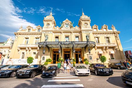 Monte Carlo, Monaco - June 13, 2016: Expensive cars near famous Casino building in Monte Carlo in Monaco. This Casino is a gambling and entertainment complex located in Monaco