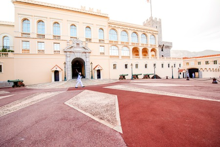 princely: Monte Carlo, Monaco - June 13, 2016: Princely Palace of Monaco with guard on the sunset. Guards unit was created in 1817 to provide security for the Palace, Sovereign Prince and his family. Editorial