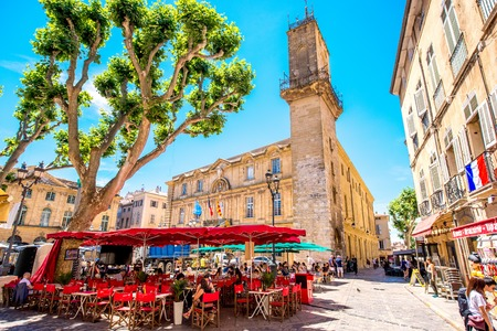 blue summer sky: Aix-en-Provence, France - June 20, 2016: Central square with cafes and bars in the old town of Aix-en-Provence city on the south of France. Editorial