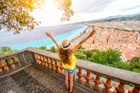 Young female traveler enjoying great view on the Nice city in France Stock Photo