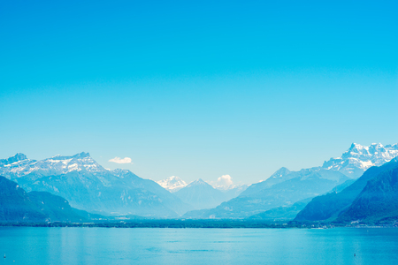 Landscape view on Geneva lake with beautiful mountains in Switzerland Stock Photo
