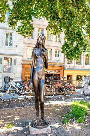 naked statue: Geneva, Switzerland - June 23, 2016: A statue of a naked, emaciated, melancholy young woman named Clementine in the old town of Geneva. The statue was created by Swiss sculptor named Heinz Schwarz Editorial