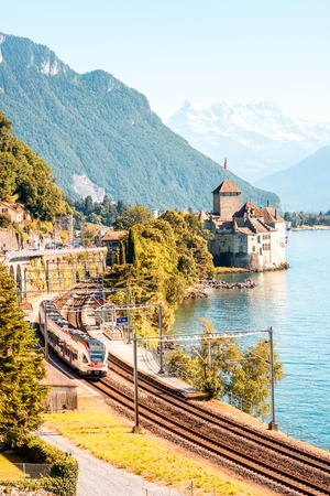 chillon: Veytaux, Switzerland - June 23, 2016: Landscape view on Geneva lake with Chillon castle and high-speed train in Switzeland