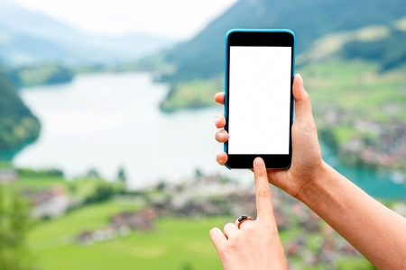 copy paste: Phone with white screen to copy paste on the landscape background in Switzerland