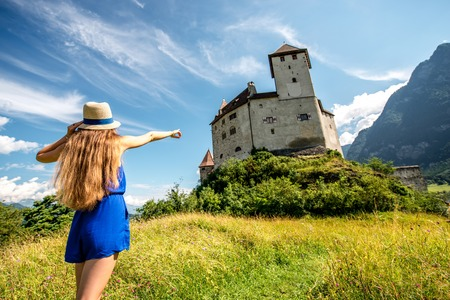 Balzers, Liechtenstein - July 01, 2016: Young female tourist visits Gutenberg castle Balzers town. Gutenberg is one of the five castles of Liechtenstein Editorial