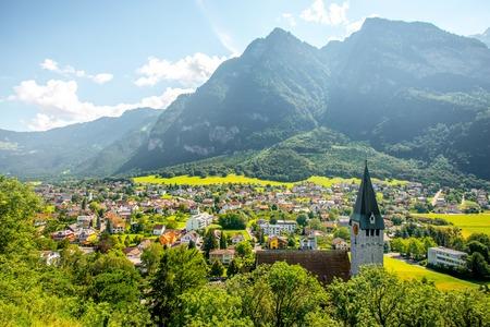 Landscape view on Balzers village with saint Nicholas church in Liechtenstein Stock Photo