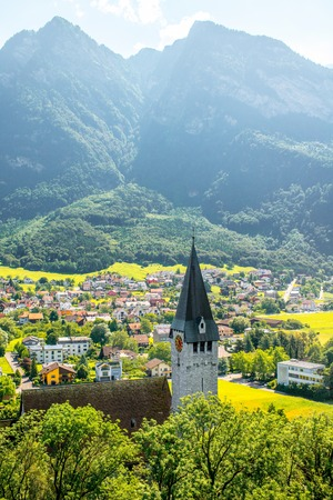 Landscape view on Balzers village with saint Nicholas church in Liechtenstein Stock Photo