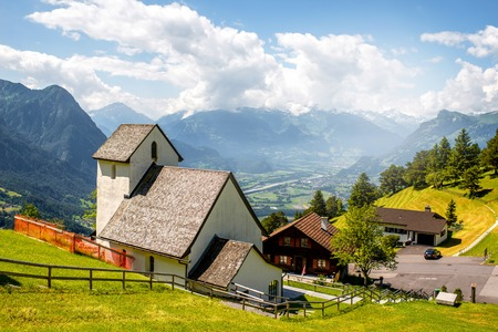 Beautiful rural scene in Triesenberg village with mountains in Liechtenstein