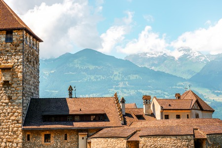 Vaduz, Liechtenstein - July 01, 2016: Landscape view on the roofs of Vaduz castle in the capital of Liechtenstein. This castle is the palace and official residence of the Prince of Liechtenstein Editorial