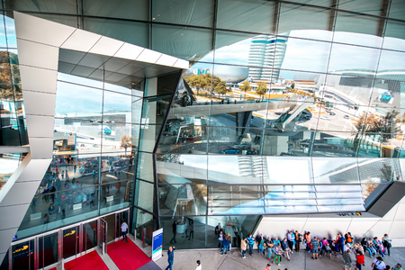 refelction: Munich, Germany - July 03, 2016: Facade of BMW world building with the refelction in Munich. BMW World is a multi-use exhibition center used for promotional events, and where buyers take BMW vehicles