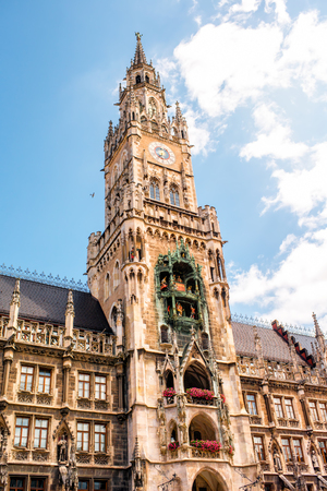 Close-up view on the clock tower of the main town hall on Marys square in Munich, Germany