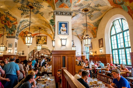Munich, Germany - July 03, 2016: Crowded interior of famous Hofbrauhaus pub in Munich. Hofbrauhaus is a biggest brewery and beer pub owned by the Bavarian state government. Editöryel