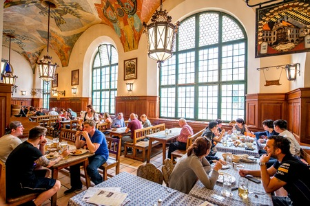 brewery: Munich, Germany - July 03, 2016: Crowded interior of famous Hofbrauhaus pub in Munich. Hofbrauhaus is a biggest brewery and beer pub owned by the Bavarian state government. Editorial
