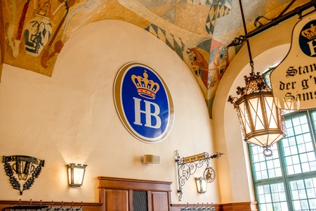 state owned: Munich, Germany - July 03, 2016: Interior of famous Hofbrauhaus pub in Munich. Hofbrauhaus is a biggest brewery and beer pub owned by the Bavarian state government.