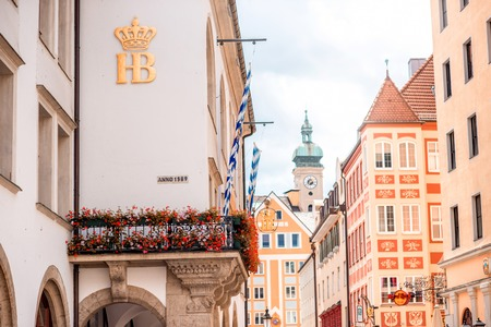 state owned: Munich, Germany - July 03, 2016: Streetview with Hofbrauhaus pub in Munich. Hofbrauhaus is a biggest brewery and beer pub owned by the Bavarian state government.