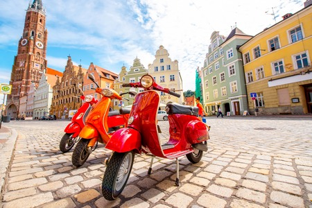 landshut: Landshut, Germany - July 04, 2016: Retro red Vespa scooters on the street in Landshut old town in Germany.