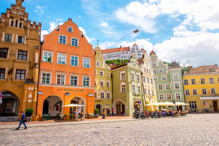 landshut: Landshut, Germany - July 04, 2016: Crowded street with colorful houses in the center of Landshut old town, Germany