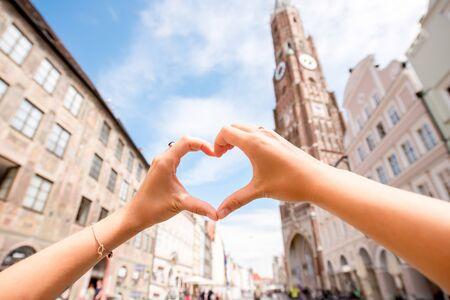 landshut: Heart shape made with hands on bavarian old town background in Landshut near Munich Stock Photo