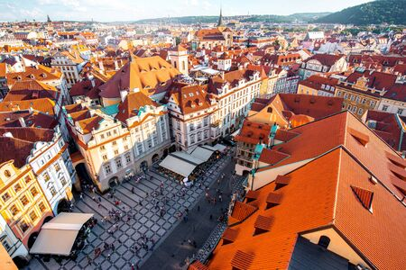 giles: Top cityscape view on the old town square from the clock tower during the sunset in Prague