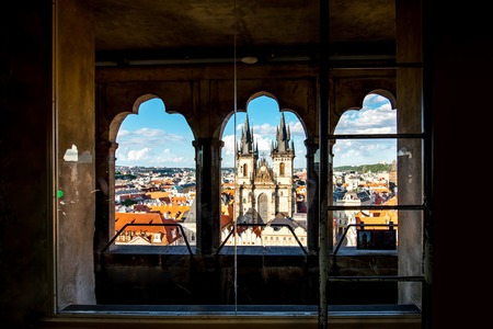 tynsky church: Cityscape view on the Tyn cathedral from the clock tower in the old town of Prague