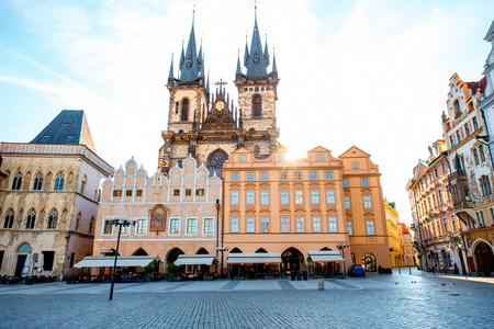 View on the old town square with famous Tyn cathedral on the sunrise in Prague