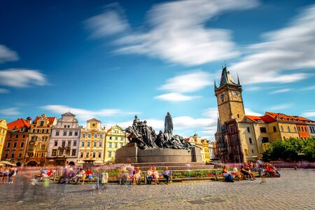 View on the old town square with the famous clock tower in Prague city. Long exposure image technic with blurred people and clouds Stockfoto