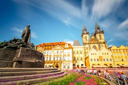 View on the famous cathedral and monument on the old town square in Prague city. Long exposure image technic with blurred people and clouds