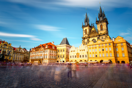 View on the famous cathedral on the old town square in Prague city. Long exposure image technic with blurred people and clouds