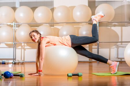 fitball: Young woman making exercise with fitball in the fitness room Stock Photo