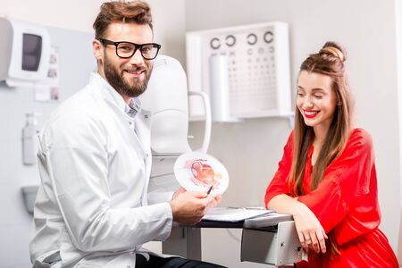 eye doctor: Eye doctor with young female patient having cosultation in the ophthalmologic cabinet