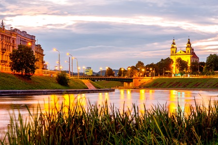Landscape night view on the river and illuminated old town of Vilnius, Lithuania Stock Photo