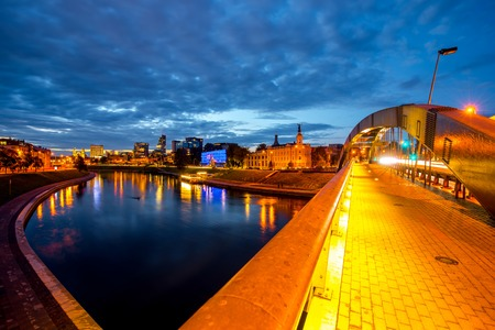 Night view on the illuminated bridge and modern district in Vilnius, Lithuania Stock Photo