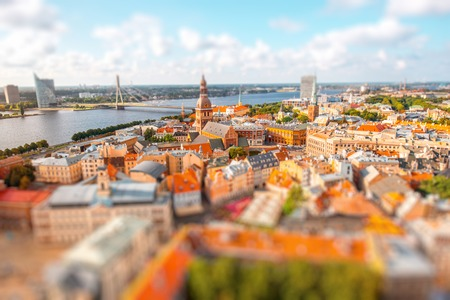Panoramic aerial view on the old town of Riga city, Latvia. Blurred image with tilt-shift effect