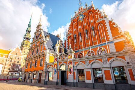 View on the central square with famous houses of Blackheads and cathedral tower in Riga city, Latvia Stock Photo