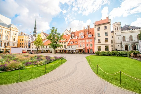 latvia: Livu square with beautiful flowerbed and buildings in the old town of Riga, Latvia