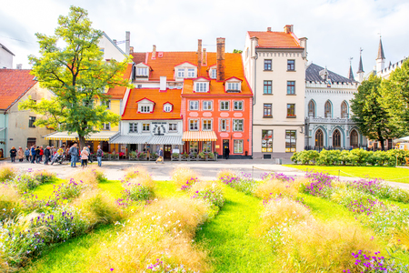 Riga, Latvia - September 23, 2016: Livu square with beautiful flowerbed and buildings in the old town of Riga, Latvia Editorial