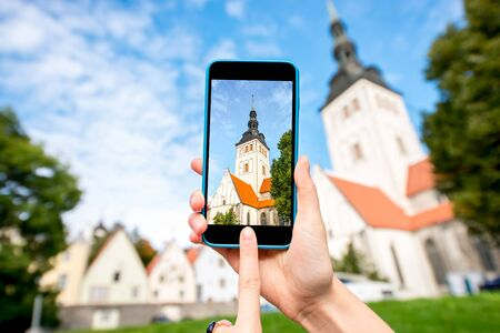 Photographing with smart phone saint Nicholas church in the old town in Tallinn, Estonia Stock Photo
