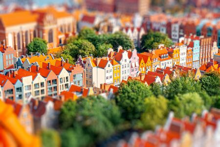 Aerial cityscape view on the old town with beautiful coorful buildings in Gdansk, Poland. Image with tilt-shift blurred effect