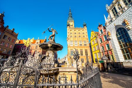 neptun: View on the town hall and famous Neptune fountain in the center of the old town of Gdansk, Poland