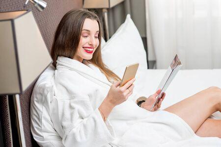 woman bathrobe: Woman in bathrobe on the bed Stock Photo